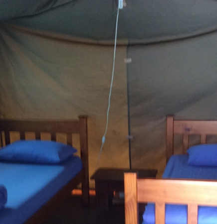 Tent with three single beds and bedding
